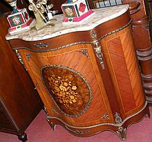 A marble top French cabinet