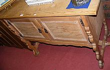 An antique French pine sideboard with cupboards below