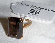 A 9ct gold smoky quartz dress ring