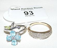 """Lady's decorative """"flower"""" ring in 18ct white gold setting (missing one sto"""