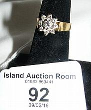 Diamond cluster ring in 18ct gold setting
