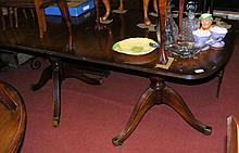 A mahogany Regency style twin pillared dining table