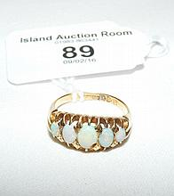 Lady's five stone opal ring in 18ct gold setting