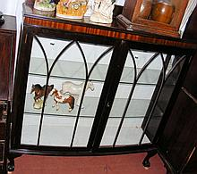 Bow front display cabinet on cabriole supports