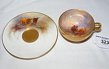A Royal Worcester cabinet cup and saucer hand painted with cattle - signed