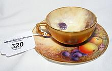 A Royal Worcester cabinet cup and saucer hand painted with fruit decoration