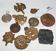 Victorian silver medals, cap badges, etc.