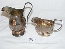 A silver cream jug with London hallmark, together with one other