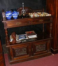 Late Victorian two tier buffet with cupboards below and drawers to the apro