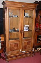 Antique French display cabinet with glazed doors and single drawer to the b