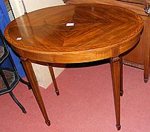 An inlaid oval antique occasional table on square tapering supports