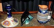 A Doulton Lambeth stoneware jug, together with Poole Pottery Dolphin, etc.
