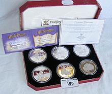 Set of six Harry Potter Commemorative Coins in pre