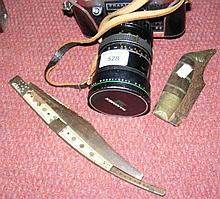 Two Eastern folding knives and a Praktica
