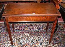 A 19th century mahogany fold-over tea table