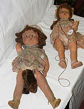 A bisque head doll and one other