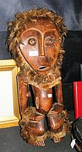A 66cm high carved wooden African figure