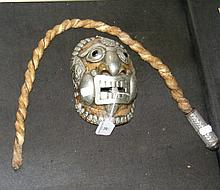An unusual metal ornamental mask with glass eyes,