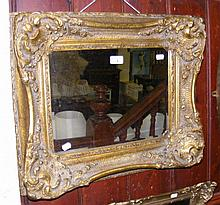 Decoratively gilt framed wall mirror