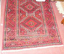 Middle Eastern rug with red ground - 190cm x 94cm