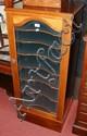 A mahogany sheet music cabinet with glazed door