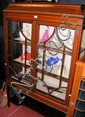 An Edwardian display cabinet with cross-banded