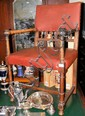 An antique desk chair with turned armrests