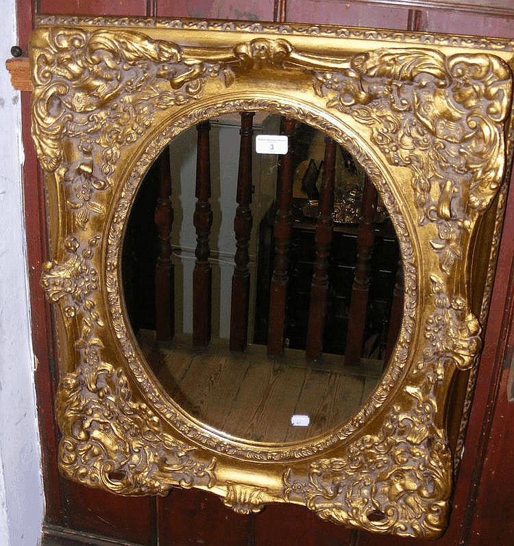 A decorative hall mirror in gilt frame