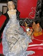 An old tinplate chicken toy, monkey and doll