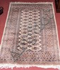 A small Middle Eastern style hall rug