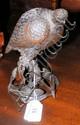 An antique bronze model of a game bird - 19cm high