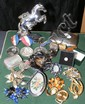 A silver cigarette case, costume jewellery, etc