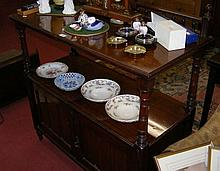 A late Victorian mahogany two tier buffet with cupboards below