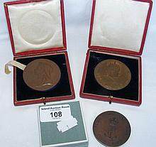 Two commemorative medallions, including 1902 Coronation Medal and one other