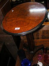 Burr walnut wine table with shaped column