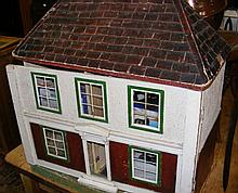 An old Tri-ang style dolls house with fitted interior and furniture