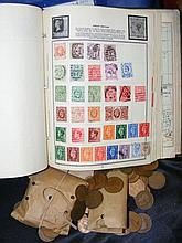 An album containing various stamps from around the world, together with oth