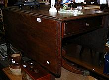 A 19th century mahogany drop-leaf table with side drawer on turned pillar a