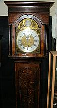 An 18th century oak cased longcase clock with arched brass dial and silver