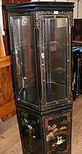 An oriental display cabinet with cupboards below and applied work decoratio