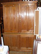 An old pine panelled cupboard - 152cm
