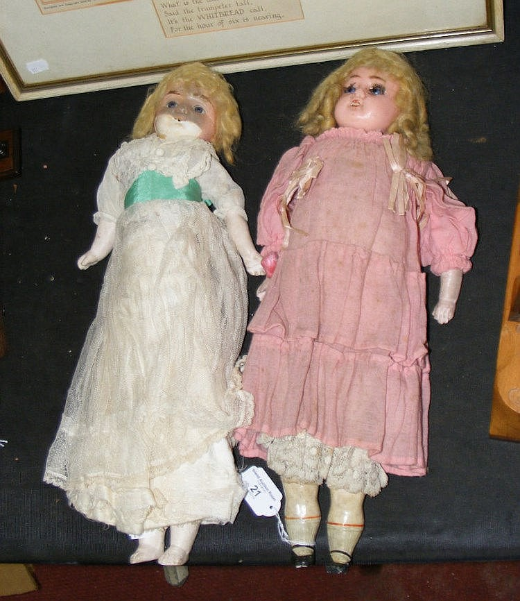 A Victorian wax head doll and one other