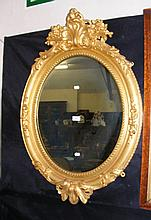 Decorative gilt framed oval wall mirror