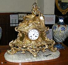 An attractive French antique gilt striking mantel