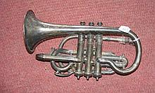 A decoratively engraved early plated cornet by A