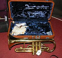 A Chinese brass cornet complete with fitted