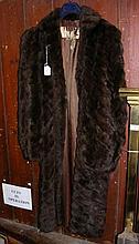 A lady's full length fur coat