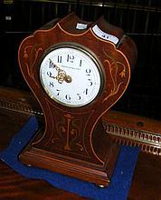An Edwardian inlaid mahogany cased mantel clock