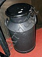 A black painted milk churn complete with lid