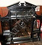 An ebonised bevelled overmantel mirror with broken